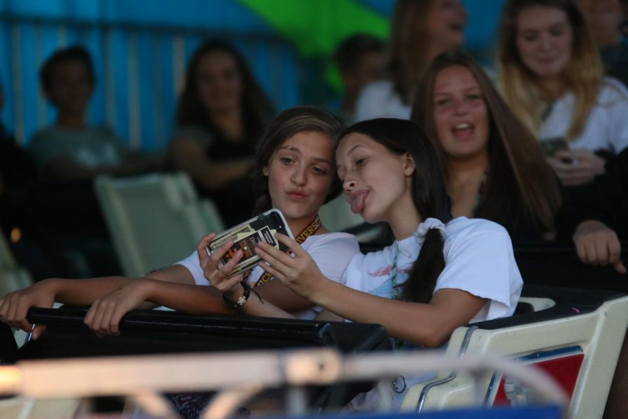 Freshman Evelyn Krusniak spent her time on Saturday at AppleFest with her friends. The St. John's AppleFest was held over the weekend, it had many pies, cakes, and games for friends.