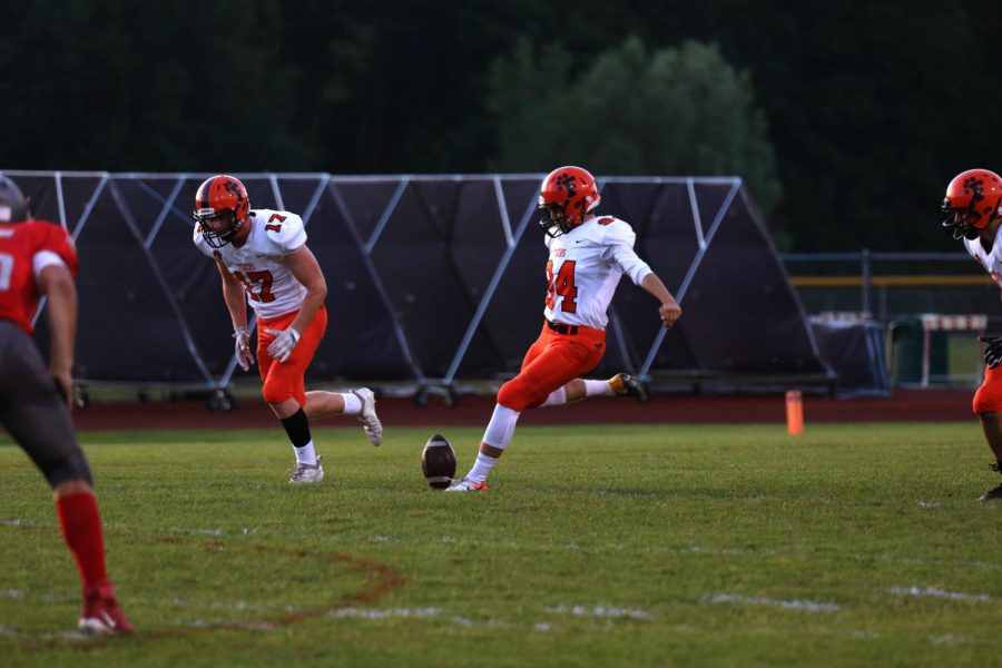 After the Tigers scored a touchdown senior Braden Moore kicks the ball for the kickoff. The Fenton varsity football team beat Holly 57-7 on Sep 20.