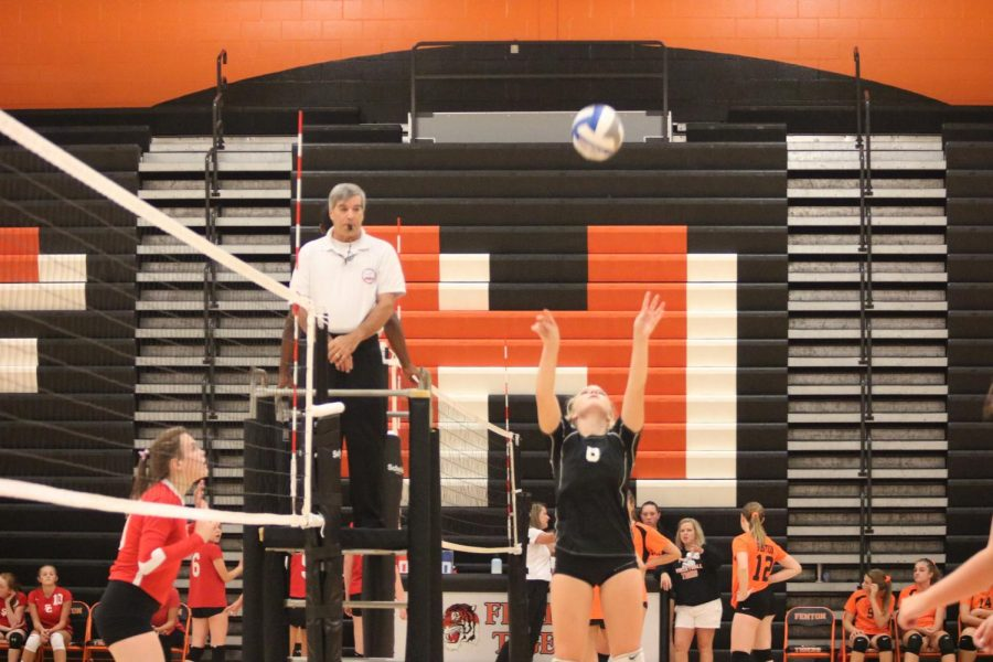 Sophomore Lizzy Wakeham, sets the ball for her teammates to hit. The Tigers won 2 out of their 3 matches against Swartz Creek.