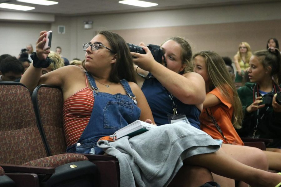 Senior Gracie Warda takes a video of a student journalist as  photo staff members take pictures behind her.  From July 28-August 2, students had the opportunity to attend the Michigan Interscholastic Press Association camp to learn and to strengthen their journalism abilities.