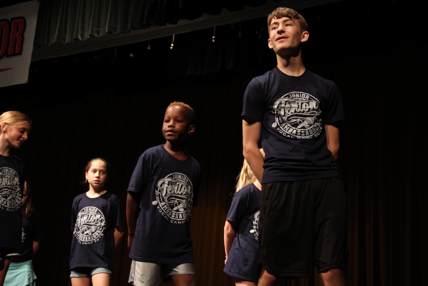 Leading the campers in a song, junior Chris Lefave sings with his friends. The Ambassadors volunteered at the Jr. Ambassadors camp the week of June 23.