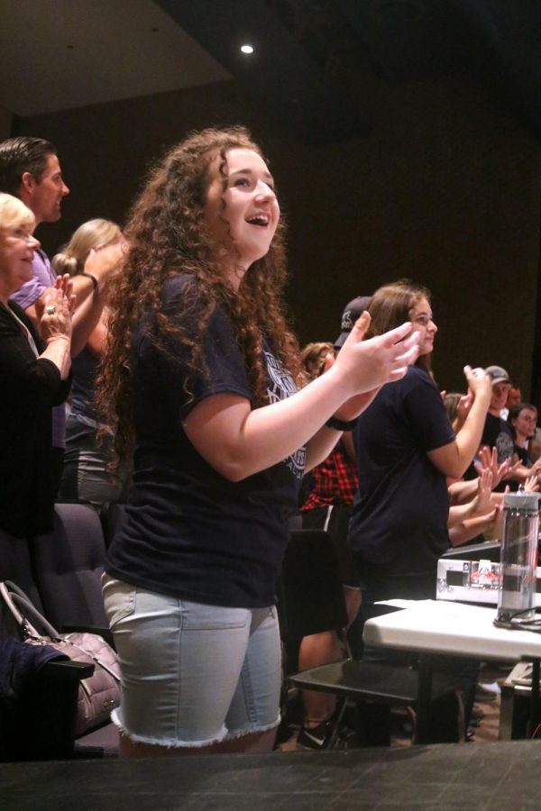 Incoming senior Jenna Maher claps for the junior ambassadors as the performance ends. Junior ambassadors camp ended with a final performance on June 28.