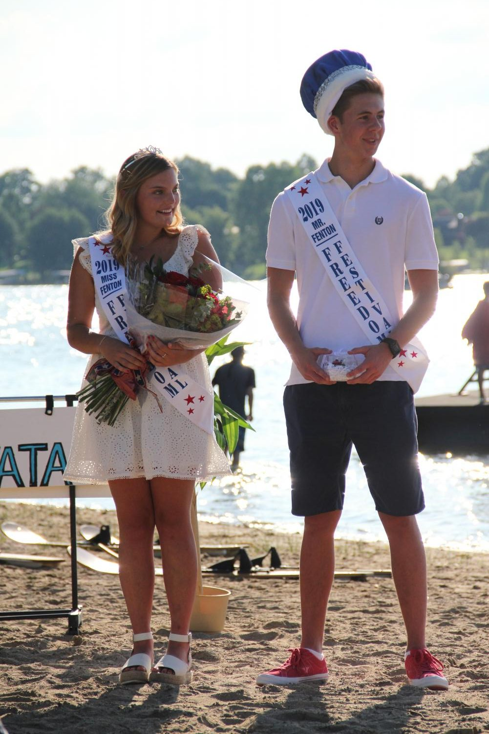 As they receive their crowns, seniors Kaitlin Gruber and Jacob Novak stand side by side at the freedom festival crowning ceremony on July 3rd.