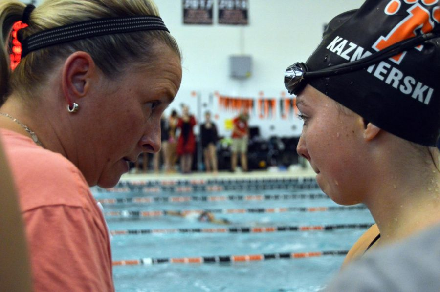After swimmer Madeline Kasmierski places third for the girls 200 yard freestyle, Coach Stephanie talks to her about how she swam. On Sept. 20, Madeline had a time of 2:10.06.