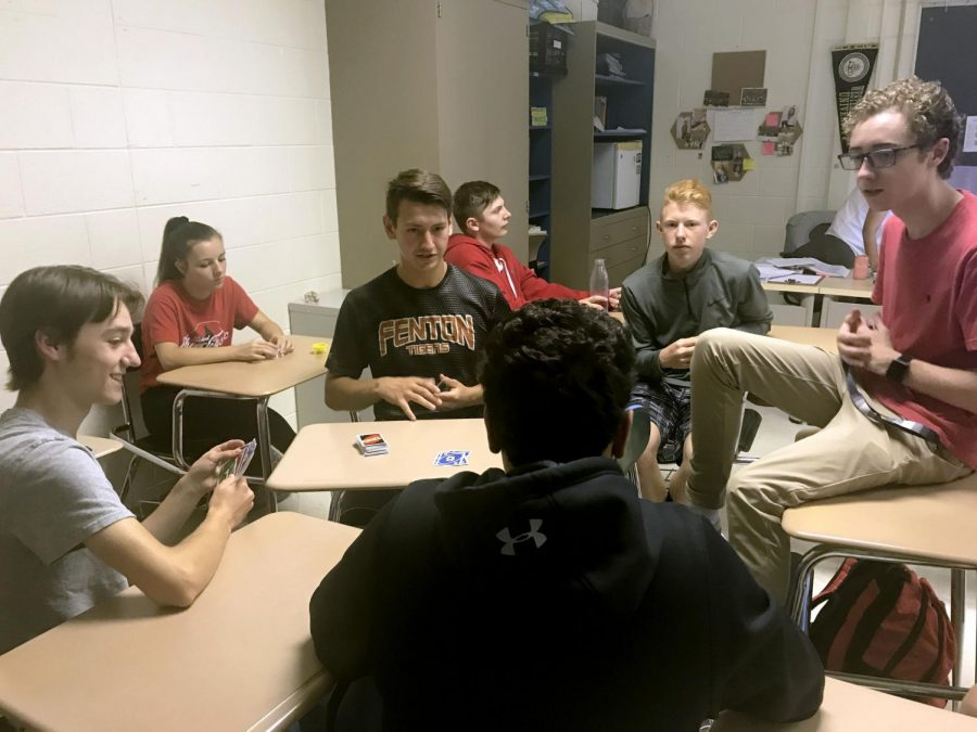 A group of juniors in Megan Ake's class start a game of Uno for Mindful Monday.  Mindful Mondays are the first 10 minutes of class where students get to do whatever they want, as long as it's not on their phone.