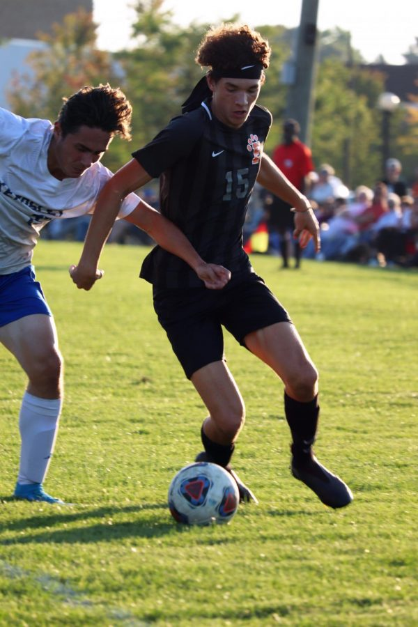 Challenging an opponent, junior Max Guerra recovers the ball. Fenton defeated Kearsley on Sept. 16.