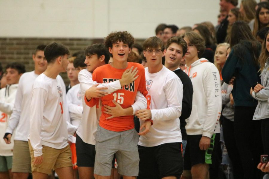 Taunting the sophomore class, junior Nate Miller holds back junior Max Guerra at the Homecoming Pep Assembly. The pep assembly preceded the Homecoming dance on Oct. 12.
