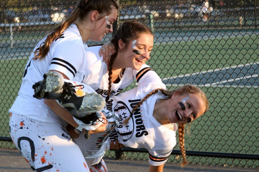 While waiting for the powderpuff game to start, juniors Lydia Anderson, Maggie Lutz and Lara Kemp attempt to take a picture. The juniors played the seniors on Oct. 7 to kick off homecoming week.
