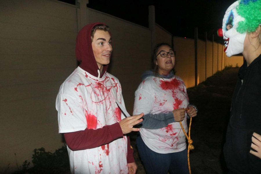 Before the haunted house opens, senior Andrew Donar talks to a staff member. The InPrint hosted a haunted house at the Ponemah Lakeside Lodge on Oct. 5 to raise money for their program.