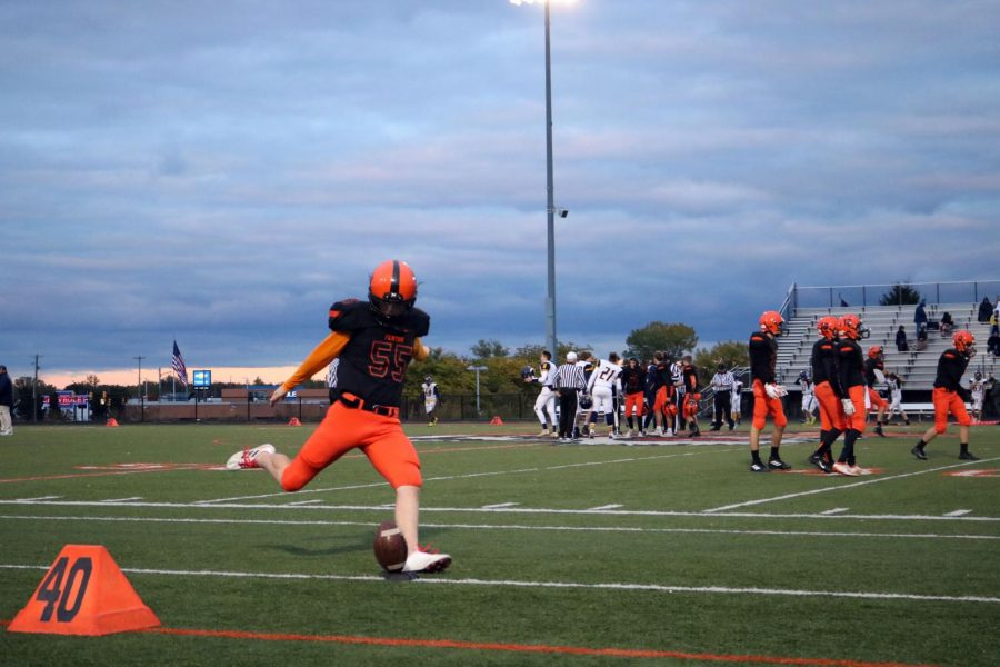 Sophomore Nick Temple is practicing his kick before the game. On October 17, the tigers were defeated by Goodrich.