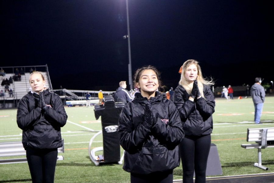 Sophomore Elizabeth Diez smiles as she cheers. On Oct 7, the Fenton Cheer Team was cheering for Fenton as they played Goodrich.