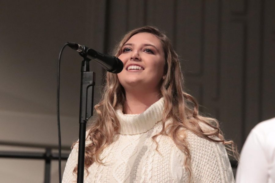 Beaming to the crowd, senior Morgan Rettenmund performs her solo. On Oct. 24, the FHS choirs hosted their annual fall informance for this school year.