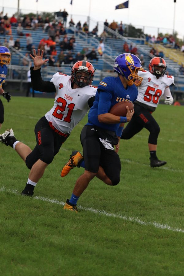 While playing defense junior Austin Henard tackles Kearsley's ball carrier. The Tigers beat the Hornets 35-13 and will play the Linden Eagles on Oct. 4.