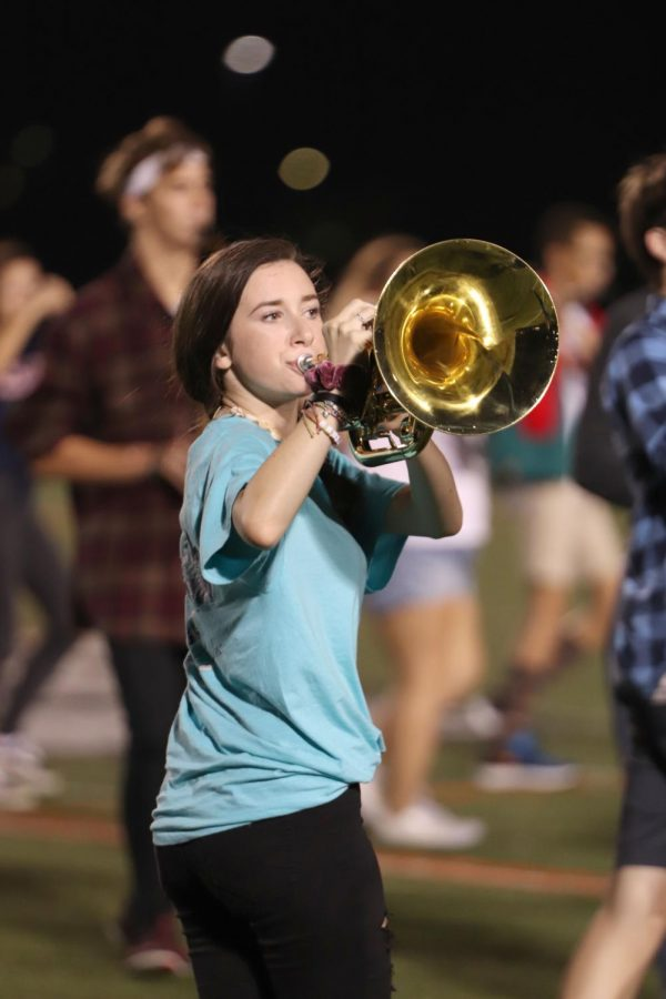 Freshman Keira Shantry comes to zero hour every morning to practice for marching band. Shantry and the rest of the band practices her big finale, the homecoming game, Oct. 11.
