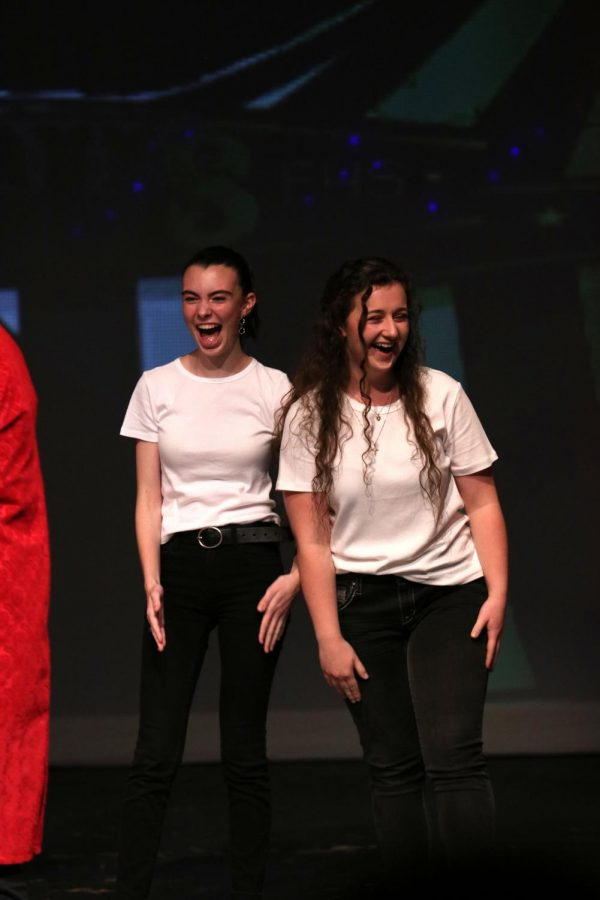 After being told they tied for first place, sophomore Addie Wright and senior Jenna Maher laugh with excitement. The IB Drama class hosted the talent show on Sept. 27.