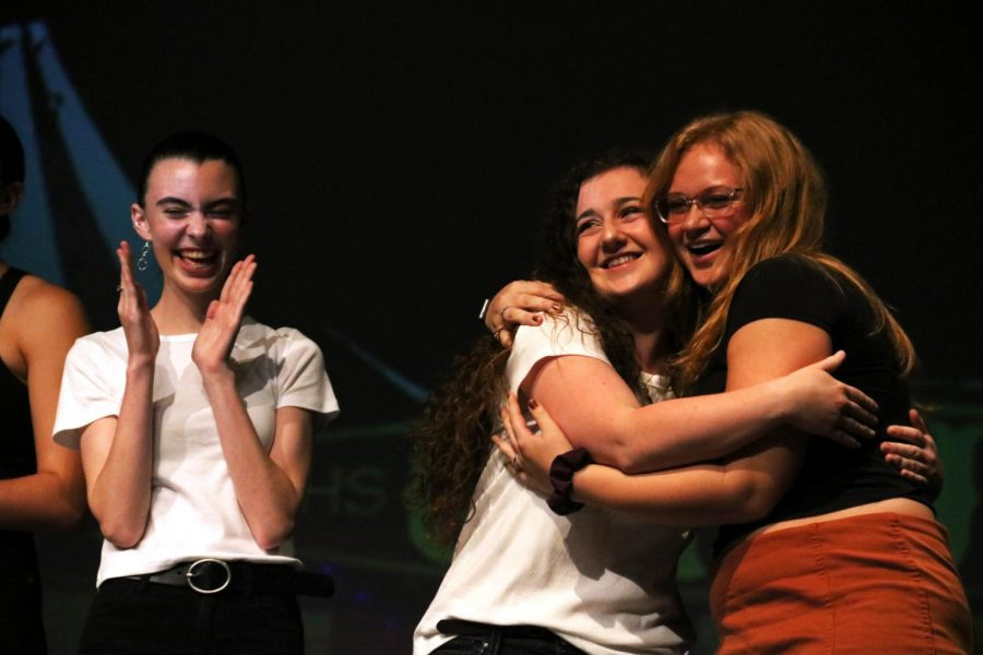 After+being+announced+tied-for-first%2C+sophomore+Addie+Wright+and+seniors+Jenna+Maher+and+Zoe+Simmerman+congratulate+each+other.+On+Sept.+26%2C+IB+Theater+hosted+the+Talent+Show.