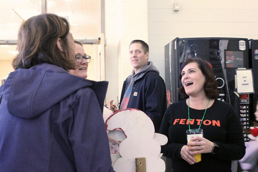 Ellen St. elementary teacher Kim Weingartz and show goers talk about the different crafts they saw at the show. The State Road Craft Show had craft vendors set up at Fenton High School on Nov. 24.