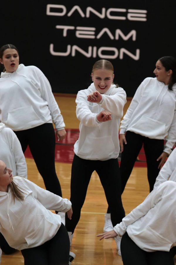 While competing at the Dance Team Union Regional Competition, junior Emilia Owocki dances with her fellow Adrenaline Dance Team members. The team placed first place with their group dance on Nov. 2.