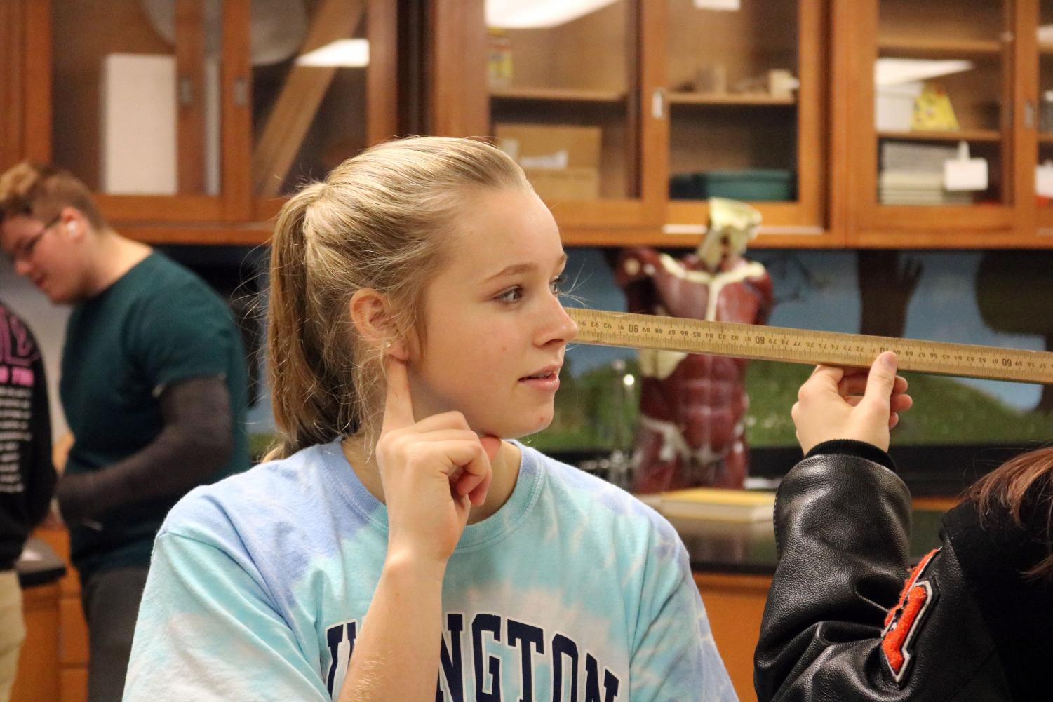 Junior Keira Chaffin, participates in an activity. On Nov. 11, anatomy students do a hearing and balance lab to go along with their unit.
