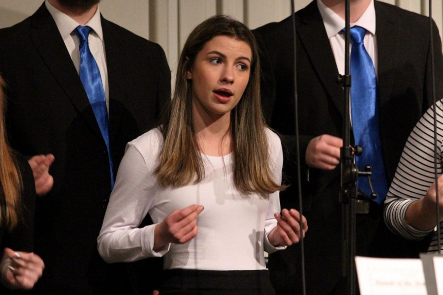 Rockin is playing as freshman Sophia Hense sings and snaps with her fingers to the beat. The all choirs holiday concert was on Dec. 10 at Fenton High School with some holiday classics.