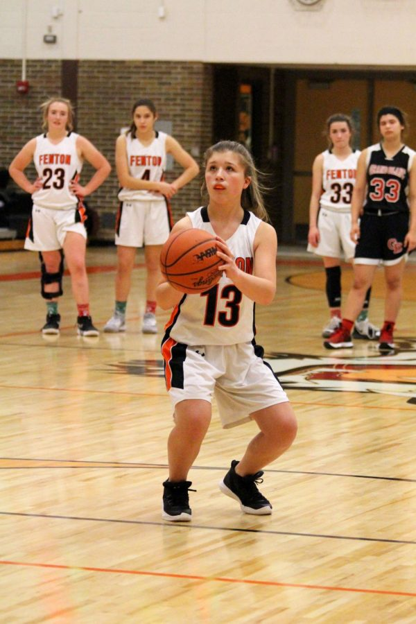 The Fenton freshman girls basketball goes against Grand Blanc on Dec. 19. Freshman Mackenzie Turner shoots the ball to score points and the team won the game 53-28.