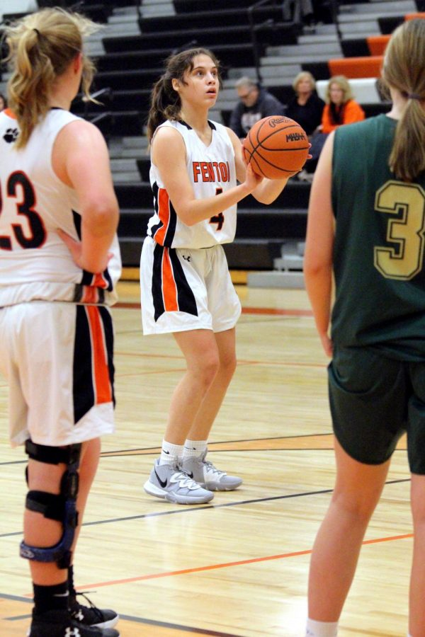 Freshman Madison Slezinski prepares to shoot the ball. Fenton beat Howell 42-15 on Dec. 17.