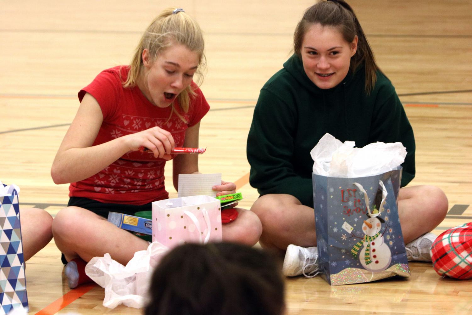 Junior Kenzie Durant is opens her gift from her secret santa. On Dec. 19, the cheer team was exchanged their secret santa gifts.