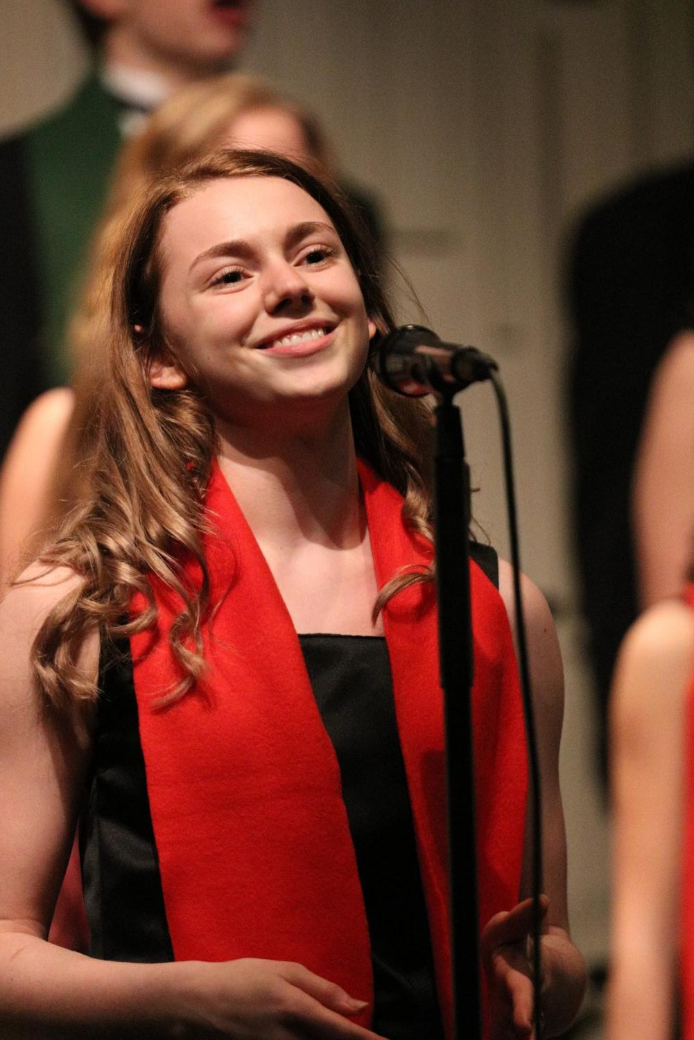 Senior Rose Muennix performs her final winter concert at Fenton High on Dec. 10. Muennix had solo that she performed for the audience at the beginning of the concert.