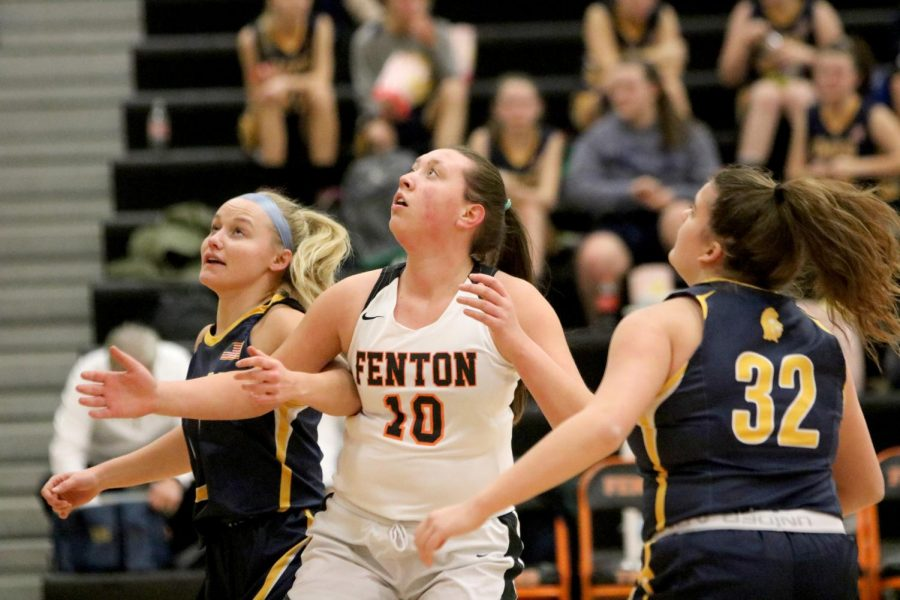 After+a+shot%2C+freshman+Adrie+Staib+watches+the+ball+go+into+the+hoop.+The+girls+varsity+basketball+team+played+the+Owosso+Trojans+at+home+on+Dec.+17+and+won+in+overtime+52-46.