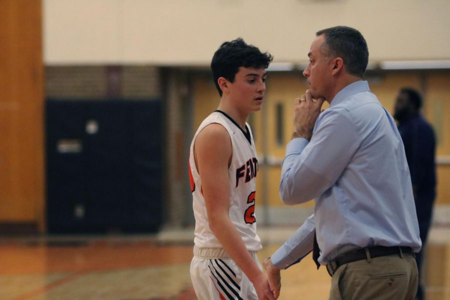 Sophomore+Sam+Claborn+high+fives+his+coaches+hand+after+playing.+On+Dec.+11%2C+The+JV+boys+basketball+team+lost+in+their+first+game+of+the+season+to+Powers.