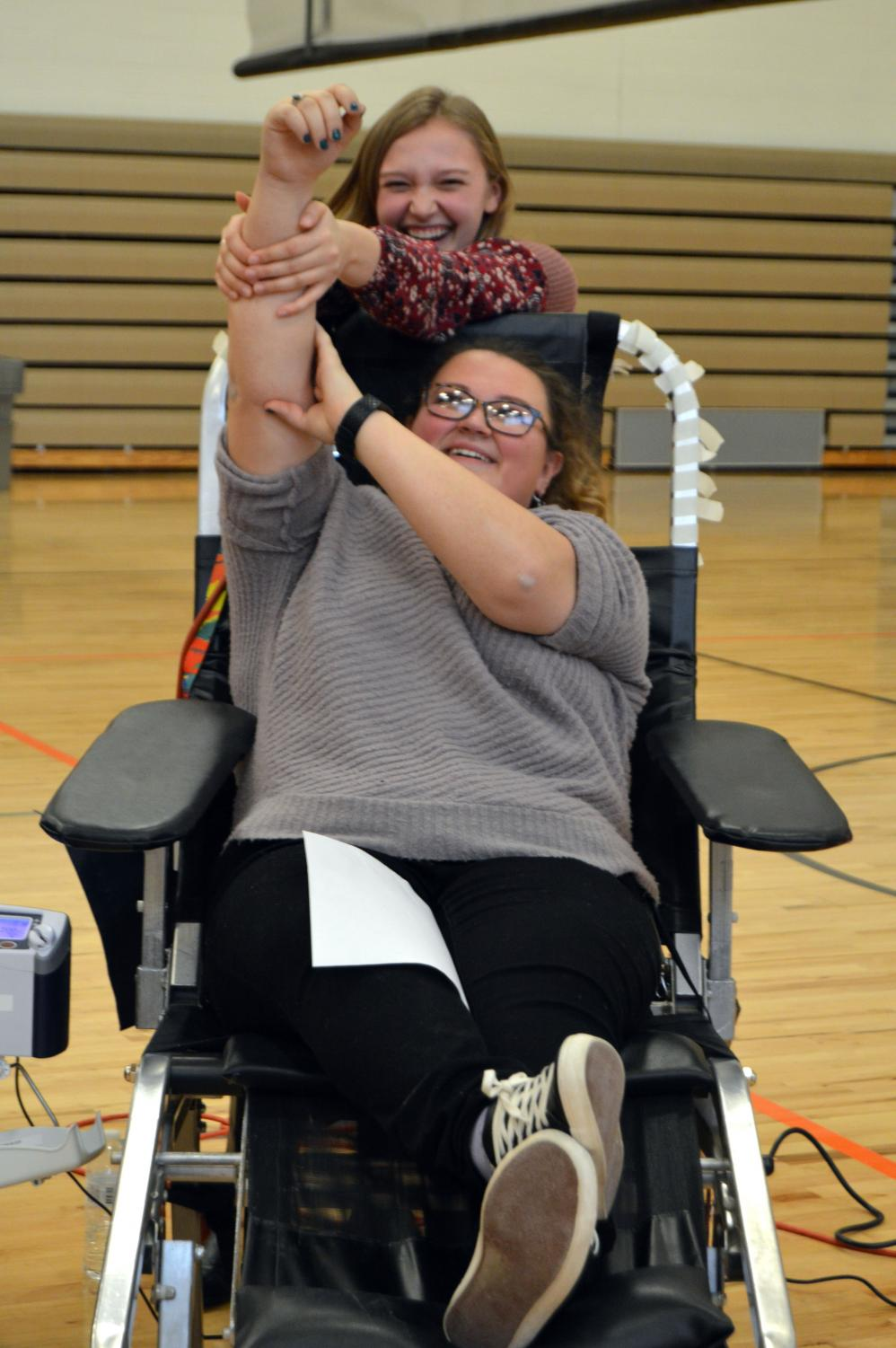 Senior Lauren Megdanoff gets her blood drawn as fellow senior Mallorie Johnson messes around trying to distract her from the blood drawn. On Jan. 9th, Fenton High School hosted a student blood drive for the day.
