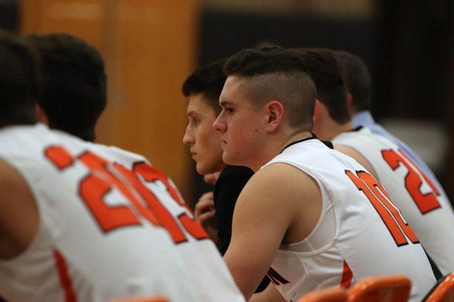 While sitting on the bench junior Dylan Davidson watches his fellow teamates play. The boys varsity basketball team played Goodrich on Jan. 7 and their next game is on Friday Jan. 10 in Kearsley.