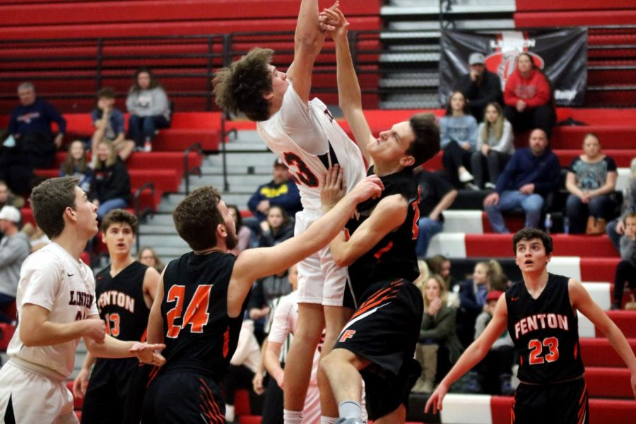 Sophomore Jasper Bakker reaches for the ball. On Jan. 16, the boys JV basketball team were defeated by Linden.