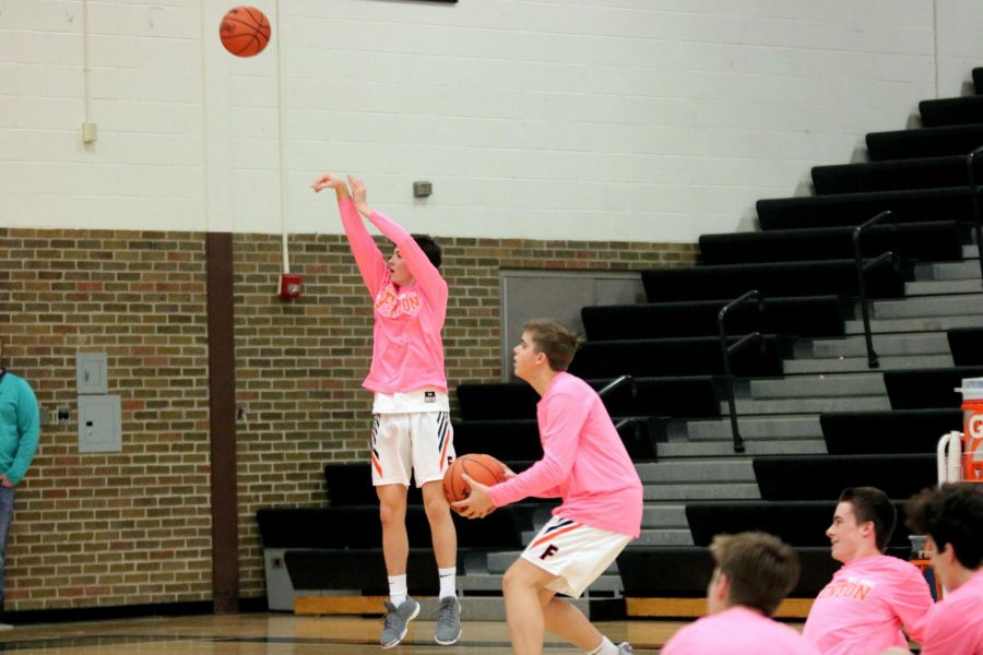 Sophomore Sam Claborn is warming up for his game. On Jan. 23, the Fenton Tigers JV Basketball team was defeated by Flushing.