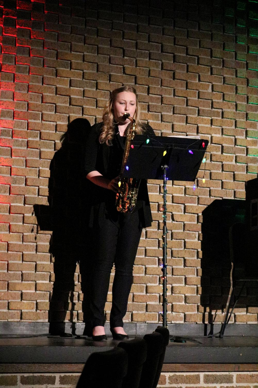 Playing the saxophone, senior Reese Strawsburg performs a solo. On Dec. 17, the Jazz Band played in front of an audience at their concert.