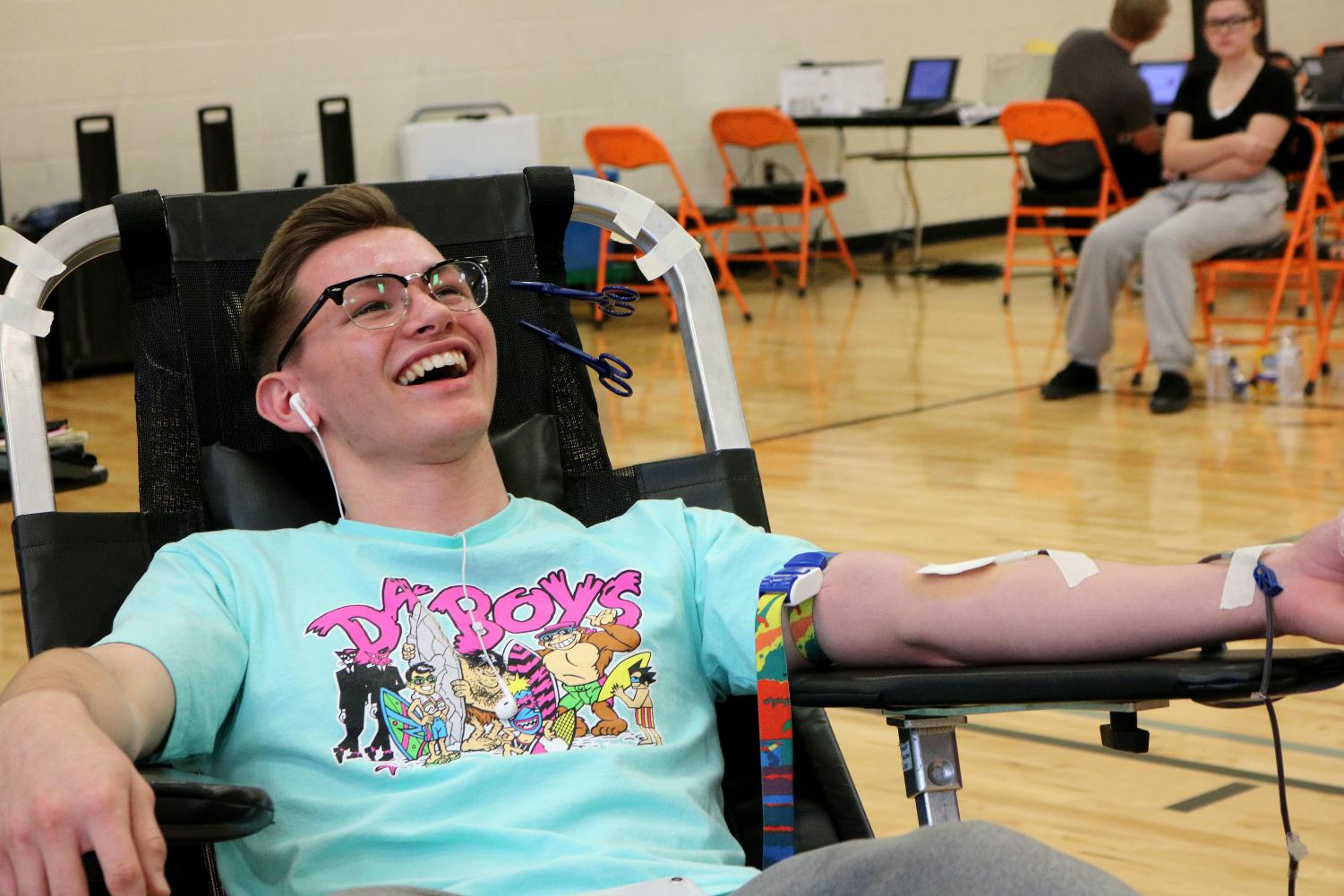 Junior Hunter Foster laughs as he gets his blood drawn. On Jan. 9 National Honor Society partnered with the Red Cross and hosted a blood drive during school in which students had the opportunity to donate and save a life.