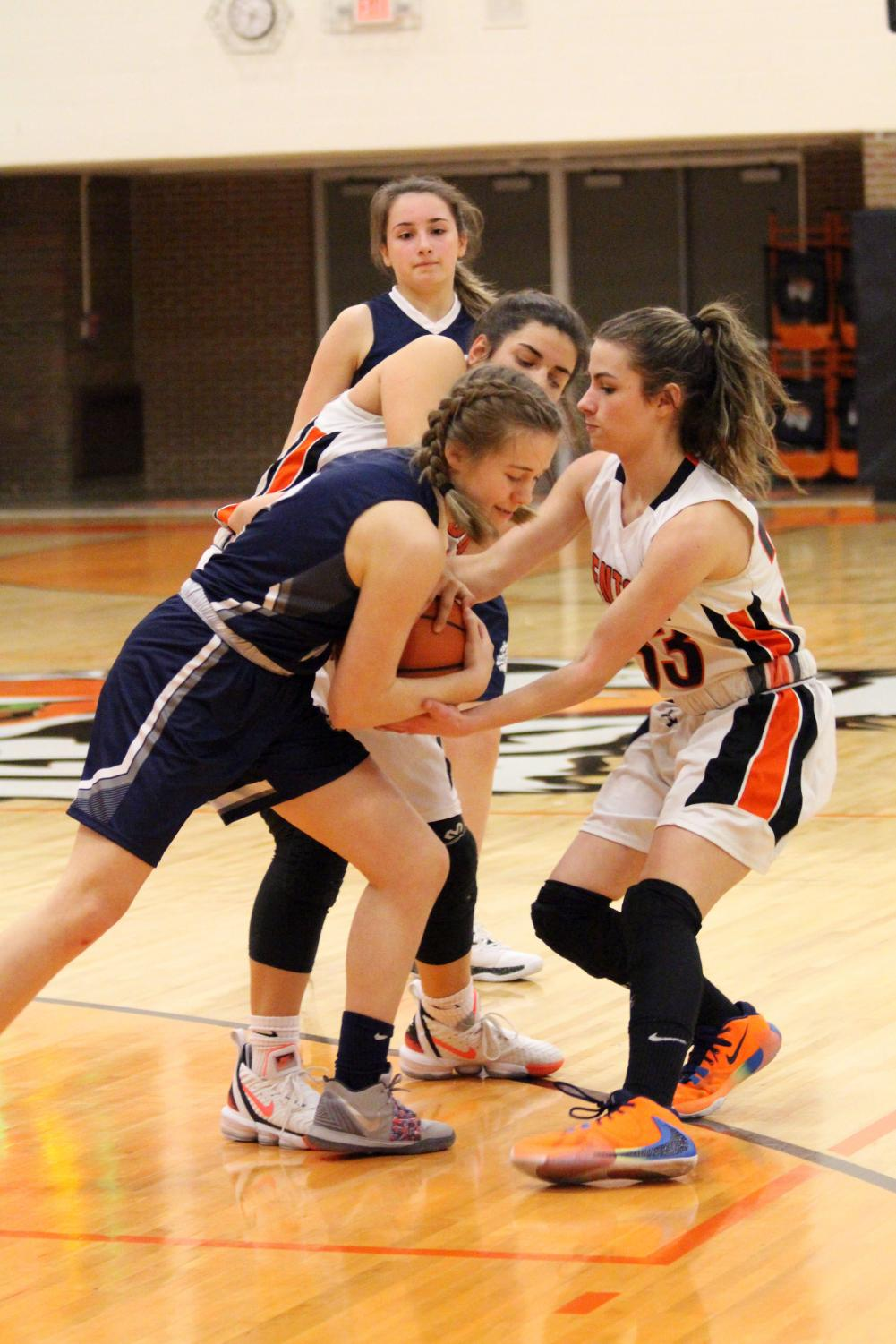 Freshman Sophia Hense tries to steal the ball from her opponent. On Jan. 22, Fenton versed South Lyon at home and won 51-16.
