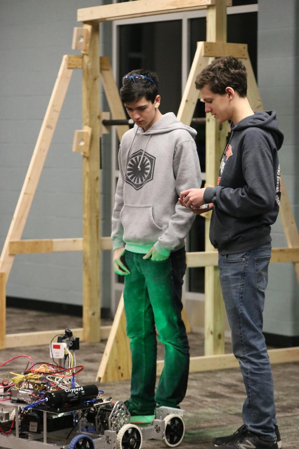 Junior Shawn DeFina and freshman Luke DeFina, members of the robotics team, work on their robot to prepare for their competition. The robotics team met on Jan. 16.