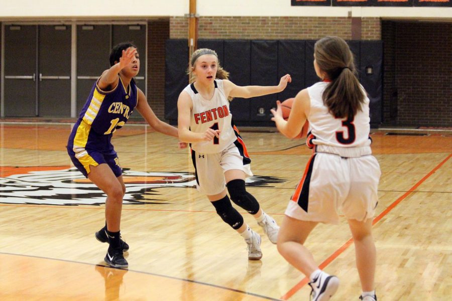 Freshman Grace MacCaughan waits for the ball to be passed to her by her teammate. On Jan. 30, the Fenton freshman girls basketball won against Bay City with a score of 41-19.