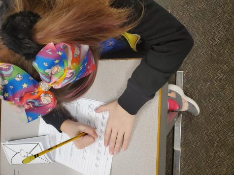 Elementary students are still learning cursive