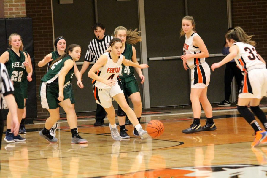 Freshman Madison Slezinski runs for the ball as everyone else notices no one has it. Fenton girls freshman basketball won against Freeland on Feb. 13 with score of 48-37.