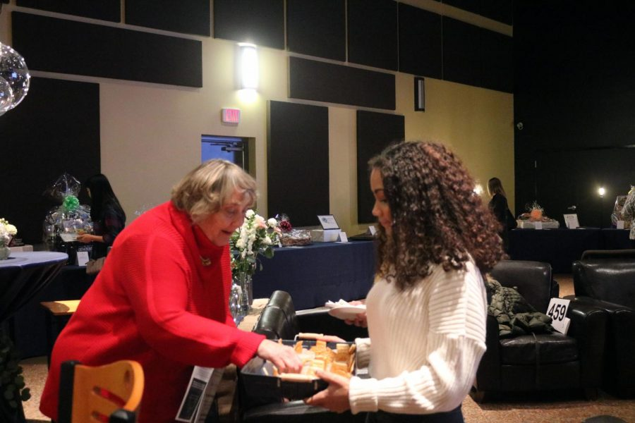 Sophomore Alexis Walker is serving food to the guests. On Feb. 7, key club was at the Freedom Center for a fundraiser for foster kids.