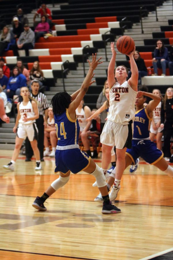 Before her opponents can block her, senior Sam Whaling makes a shot at the basket. On Feb. 14, the girls varsity basketball team played Kearsley at home, winning 53-49.