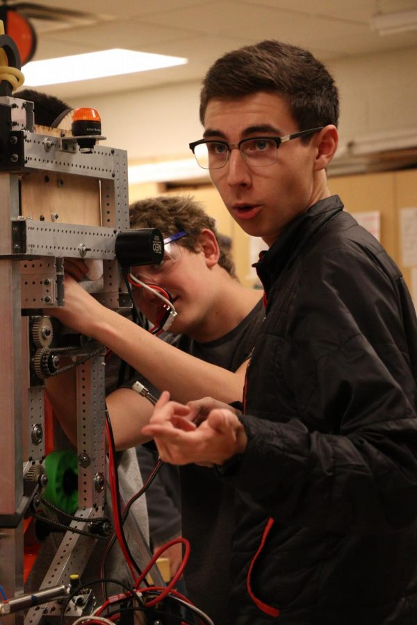 Junior Brody Stack discusses with his teammates how they should prepare their robot to perform certain tasks. On Feb. 10, the robotics team met and worked on their robot.
