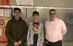 From left to right, co-founders of the Economic Club junior Joseph Henley and Aaron Toth smile next to their teacher sponsor Kevin Crimmins.