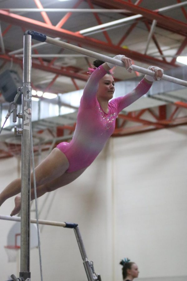 Junior Lauren Hayden competes against many teams on Feb 21. Hayden and her teammates enjoyed hanging out and bonding between each of their events.