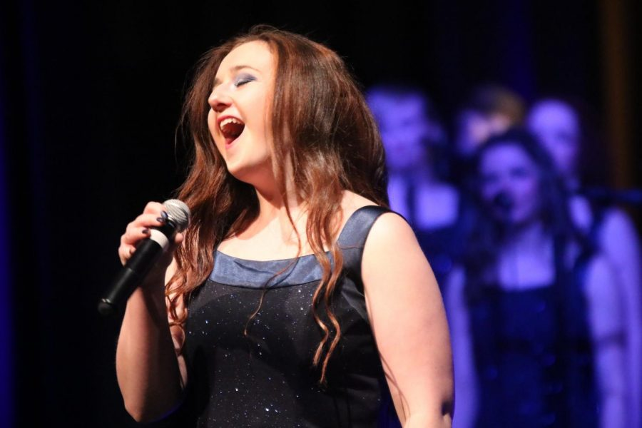 With the other Ambassadors at her side, senior Jenna Maher sings her heart out. On Feb 21 and 22 the Ambassadors put on their show
