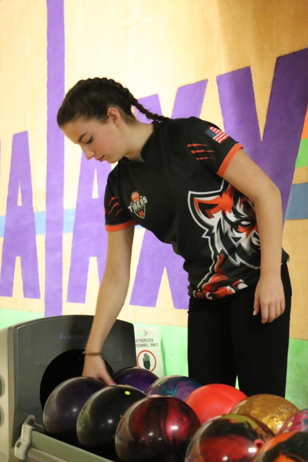 Sophomore Ella Cox grabs her bowling ball as she prepares to bowl her next frame. On Feb. 1 the girls bowling team faced Kearsley.