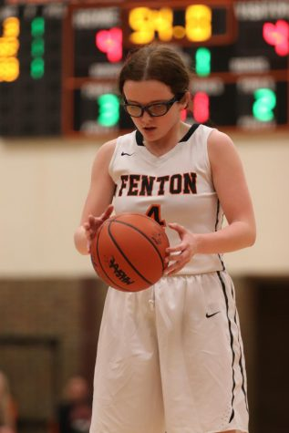 Eyes on the ball, sophomore Lauren Gangwer prepares for a free throw. The Tigers lost in a close game against Flushing 30-34 on Feb. 27.