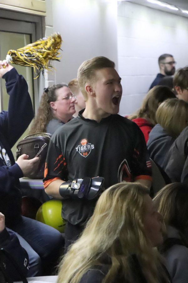 Junior Tate Temrowski cheers for his team from the sidelines on Jan. 29. Temrowski and his other teammates support each other throughout the match.
